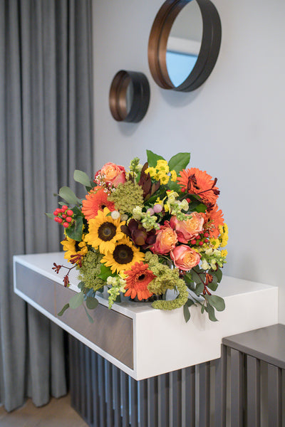 Roses, gerberas and sunflowers bouquet