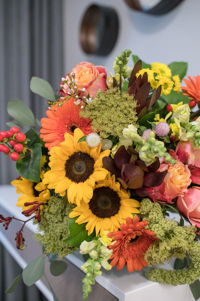 Joyful burnt orange bouquet of roses, gerberas and sunflowers