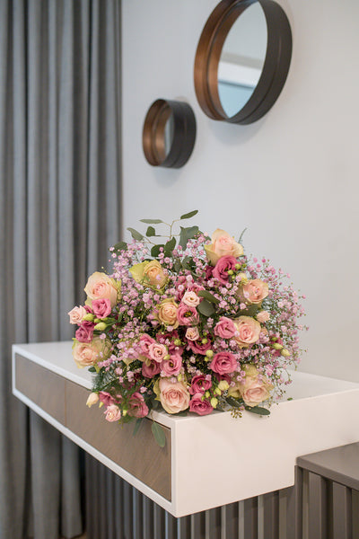 Soft pink and lilac bouquet of roses and lisianthus