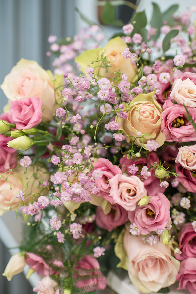 Roses and lisianthus bouquet in soft pink, ivory and lilac colours