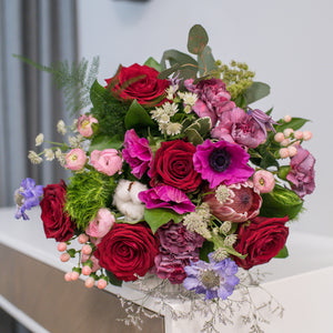 Bouquet of roses, protea, dianthus and ranunculus
