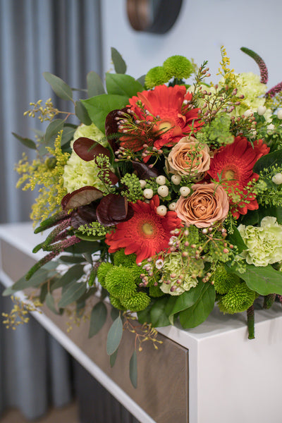 Bouquet of roses, gerberas and textural grasses