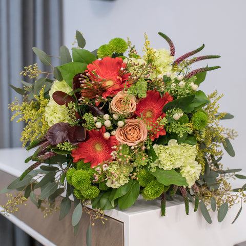 Ivory bouquet of roses, gerberas and textural grasses
