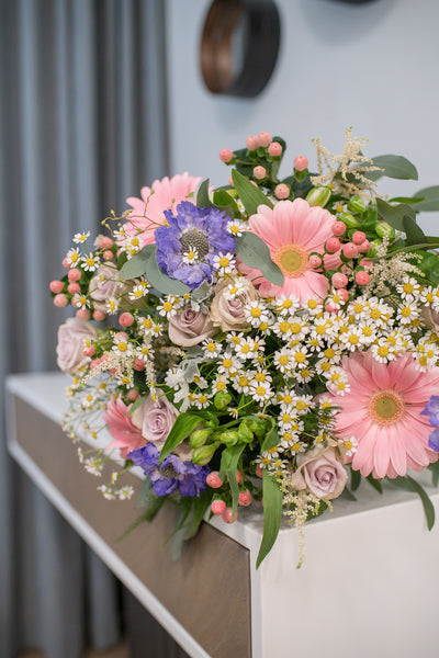 Bouquet of chamomiles, gerberas and roses