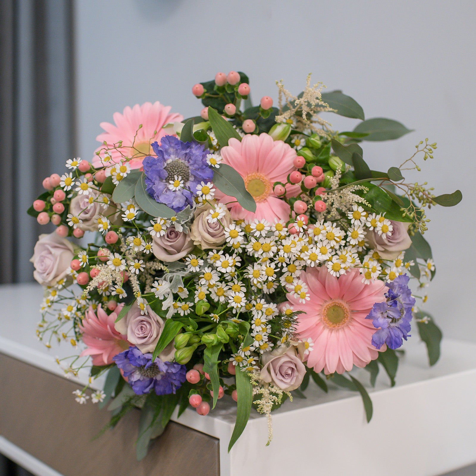 Bouquet of chamommiles, gerberas and roses