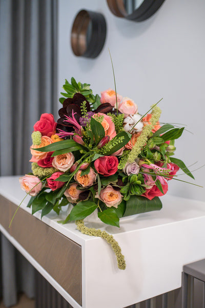 apricot, hot pink and soft creamy roses