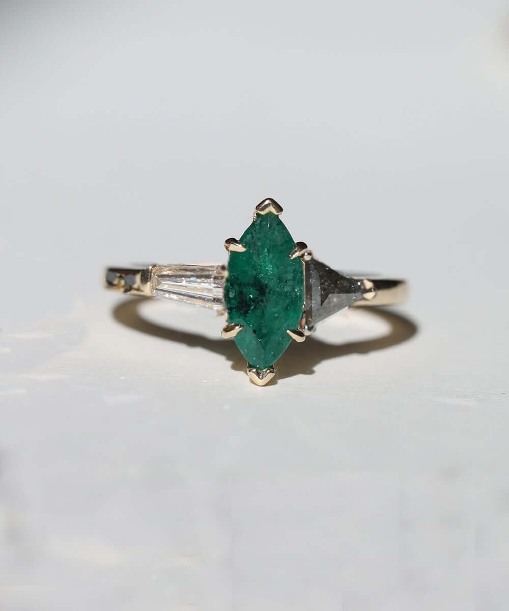 Marquise emerald triple ring