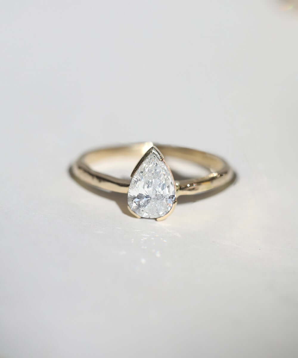 Pear diamond solitaire with Adrift setting