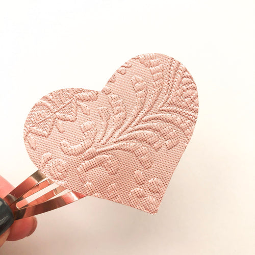 Blush Embossed Heart Snap Clip