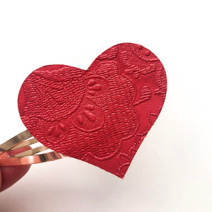 Red Embossed Heart Snap Clip
