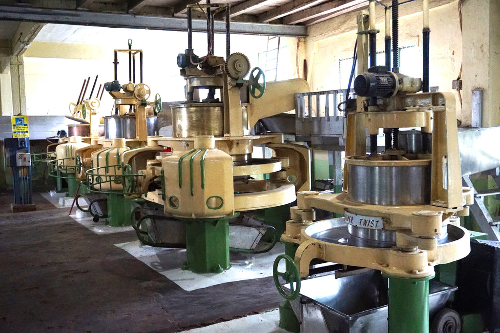 Rolling machines which are used to roll and twist the tea leaves.
