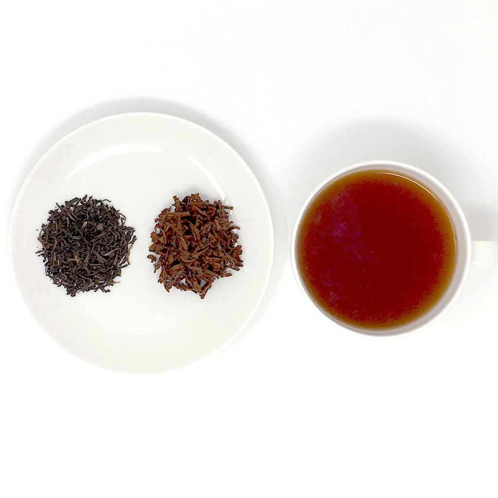 Bukhial Assam Tea cup and leaves