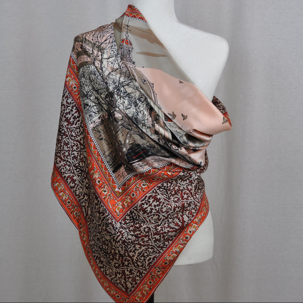 Beautiful large silk scarf features orange and rose tones with accent colors.