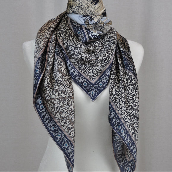 Beautiful large silk scarf features blue and grey tones with accent colors.