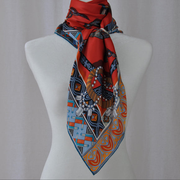Stunning silk scarf in bright red, orange, and blue.