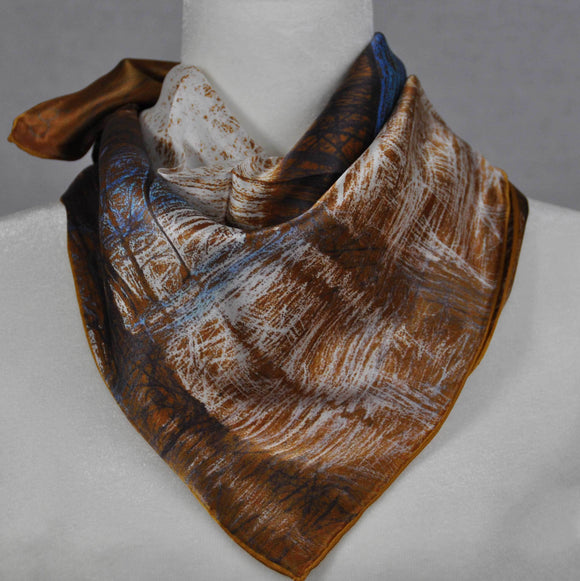 A brown and blue silk scarf tied in back.
