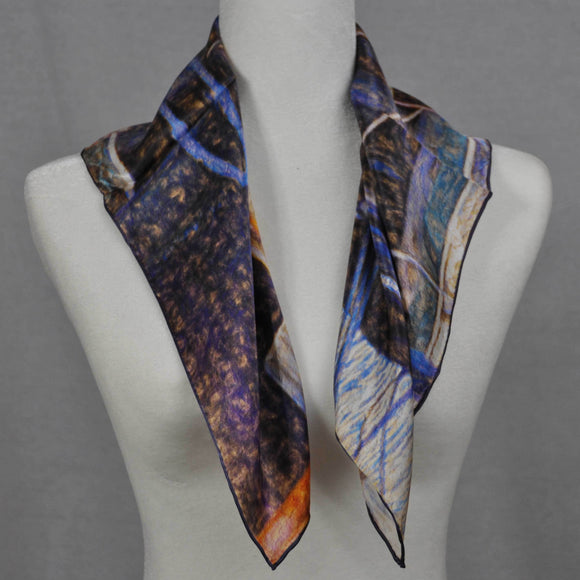 Blue, orange and purple silk scarf. We love this scarf picturing an old fishing boat off the coast of Newfoundland, Canada.