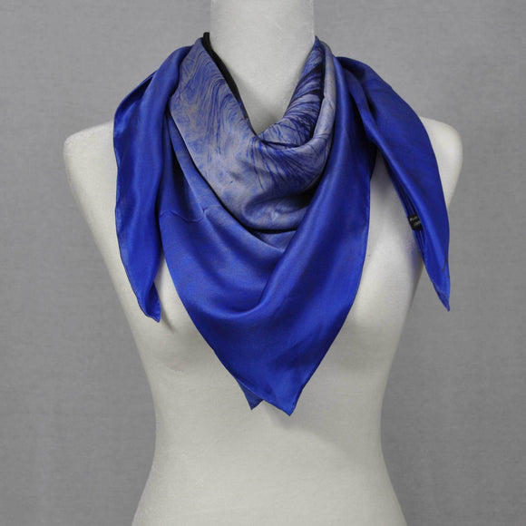 A blue silk scarf showing river scene as winter is leaving.