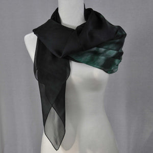 A sexy sheer black and green chiffon silk scarf to complete a day or evening look.