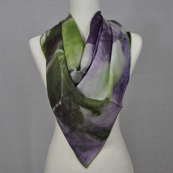 Beautiful satin silk scarf with tones of green and purple. Very feminine. Would make a great evening look with a off the shoulder dress.