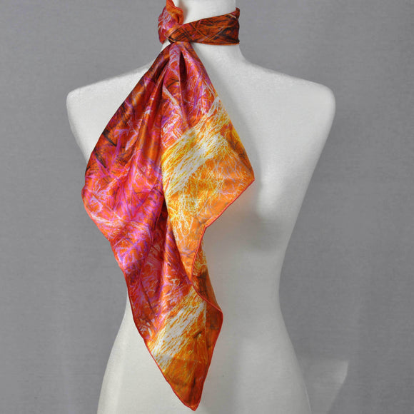 Warm orange and pink silk scarf.
