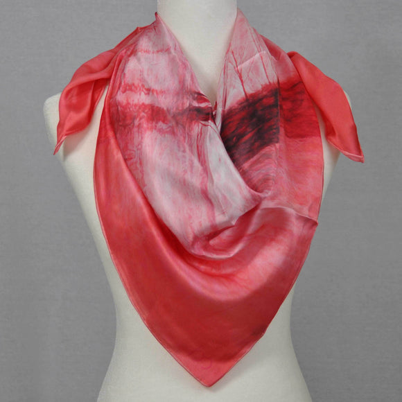 A warm rose silk scarf showing a river scene as winter is leaving.