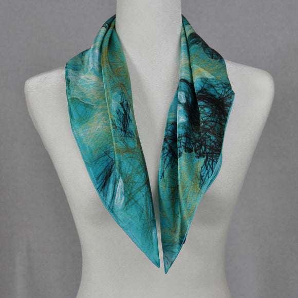 This turquoise silk scarf with gold maple leafs looks especially nice with black.   Material: 100% Silk (satin)