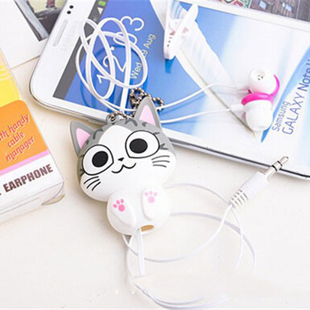 Open eyed pair of anime-style, cat-shaped headphones plugged into a Samsung phone on a white desk.