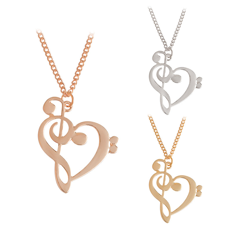 A gold, a silver, and a rose gold treble clef heart necklace.