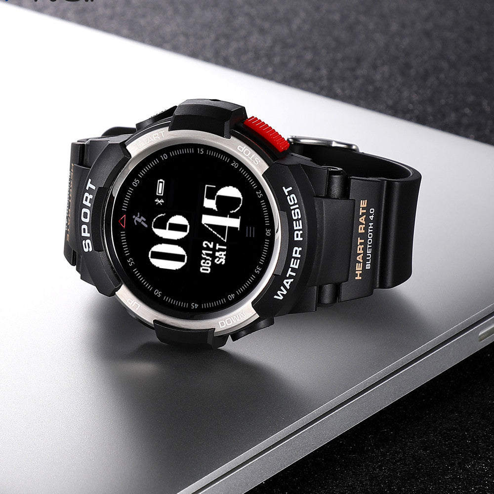 Black luxury smart watch on a light gray, steel table showing the time.