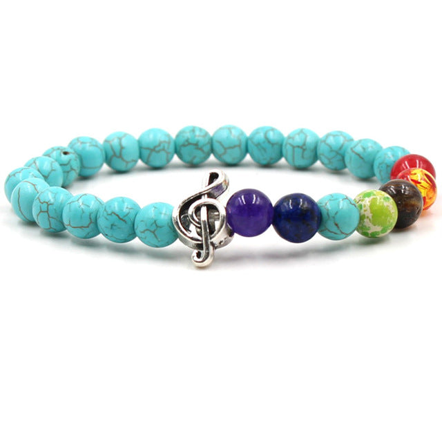 Teal stone & colored bead music bracelet with silver treble clef