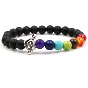 Colored lava stone & bead music bracelet with silver treble clef