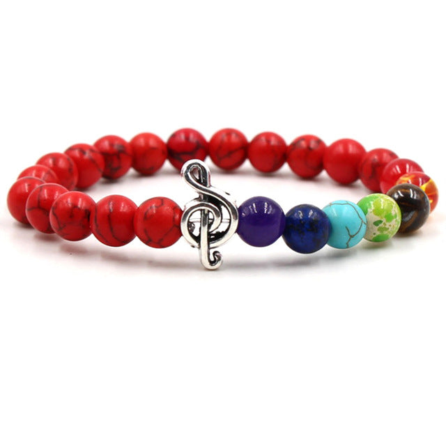 Red Colored lava stone & bead music bracelet with silver treble clef
