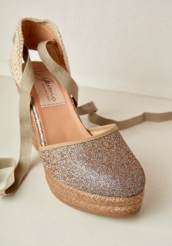 Stylish Multi glitter platform wedges having 3.5 inches heel with tie up laces and round closed toe. Very comfortable smart casual shoes to wear all day long.