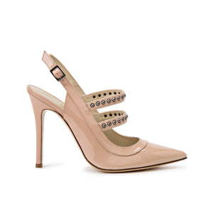 Profile of Angelina nude patent heel with two studded straps across foot and sling back with buckle
