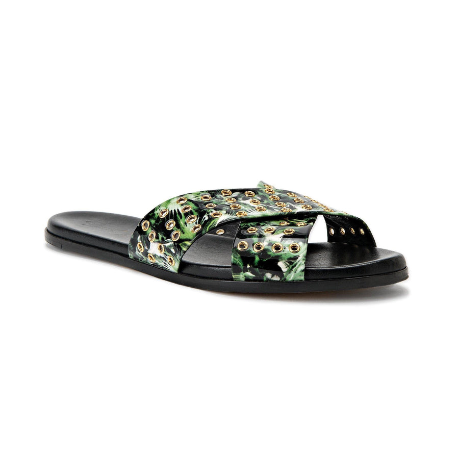 Profile of Aria green leaf patent slide sandal with hardware eyelet accents and a black sole