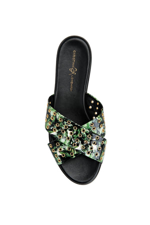 Top view of Aria green leaf slide sandal with hardware eyelets along criss-cross straps over foot