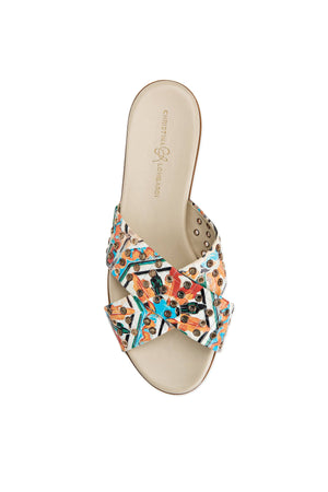 Top view of Aria maiolica tile slide sandal with hardware eyelets along criss-cross straps over foot