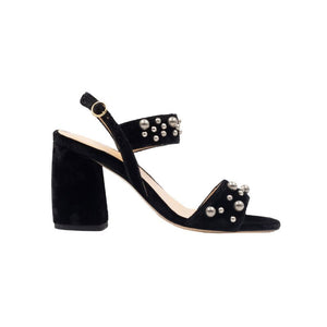 Side view of Emilia black velvet wrapped, open toe, chunky heel sandal with ankle strap
