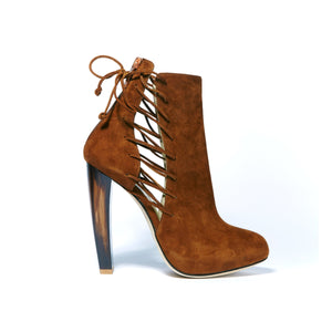 Side of Crawford Falcone Suede boot with neutral tone horn heel and side lace up accent