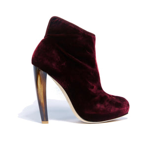 Profile of Elizabeth bacco velvet boot with complimentary neutral tone horn heel and round toe shape