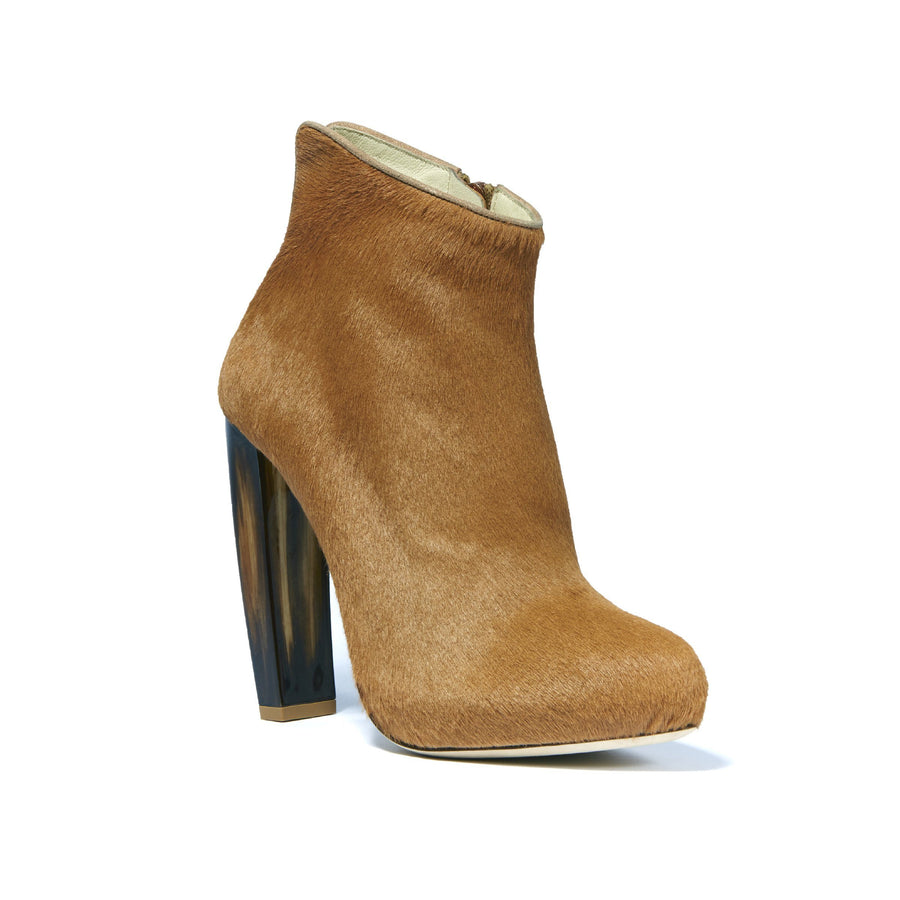 Profile of Elizabeth camel pony boot with complimentary neutral tone horn heel and round toe shape