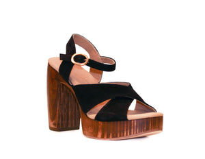 Three-quarter view of Havana retro platform sandals in black suede with wooden heel