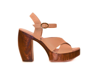Profile view of Havana retro platform sandals in nude leather with wooden heel