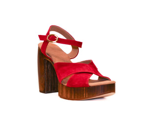 Three-quarter view of Havana retro platform sandals in red suede with wooden heel