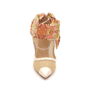 Front of nude Patent Harlyn mesh heel with open upper, silk paisley scarf ankle wrap and pointed toe