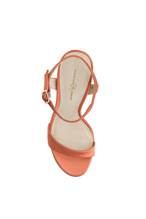 Top of Heidi burnt pepper satin open toe heel with strap across toes and around ankle. Nude sole.