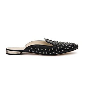 Profile of Kenzie ll black nappa leather studded flat slide with an almond toe shape and slight heel