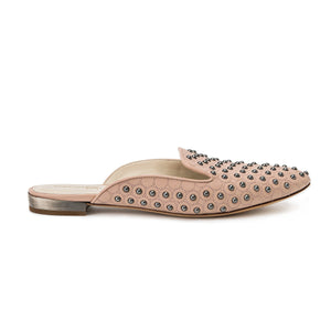 Profile of Kenzie ll nude nappa leather studded flat slide with an almond toe shape and slight heel