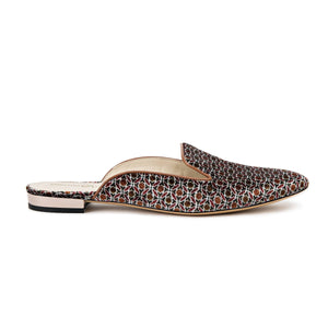 Profile of Kenzie ll velluto ornamento flat slide with an almond toe shape and slight heel